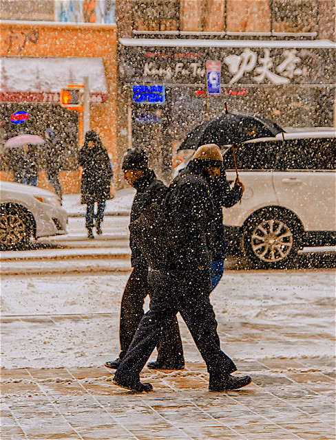 Candid of People On Wintry Cold Snowy Day on East Broadway
