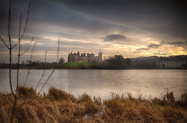 looking like a painting, fine art moody impression across the loch of winter afternoon at Linlithgow Palace and church of St Michaels, Linlithgow, West Lothian, Scotland