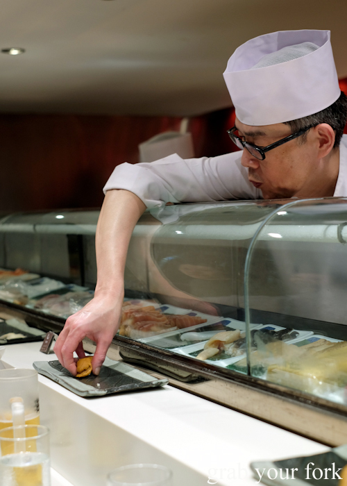 Chef Toshihiko Oe serving uni sea urchin roe sushi during his omakase at Masuya in Sydney