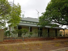 Junee. Spring Hill House built in 1885 as a residence and doctor's surgery. Occupied by doctors until 2005. The cast iron fence was erected around 1885.