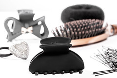 Black hair clips and hair bands with hairbrush on wh…