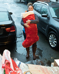 Rep. Cummings with a giant stocking filled with donated clothing collected during a Veterans Holiday Giving Tree drive.