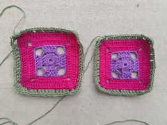 Two flamboyant afghan squares made with the same yarn