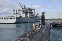 USS Oklahoma City (SSN 723), a Los Angeles-class submarine, prepares to moor next to USNS Cesar Chavez (T-AKE 14) in Apra Harbor, March 11. (U.S. Navy/MC2 Jordyn Diomede)