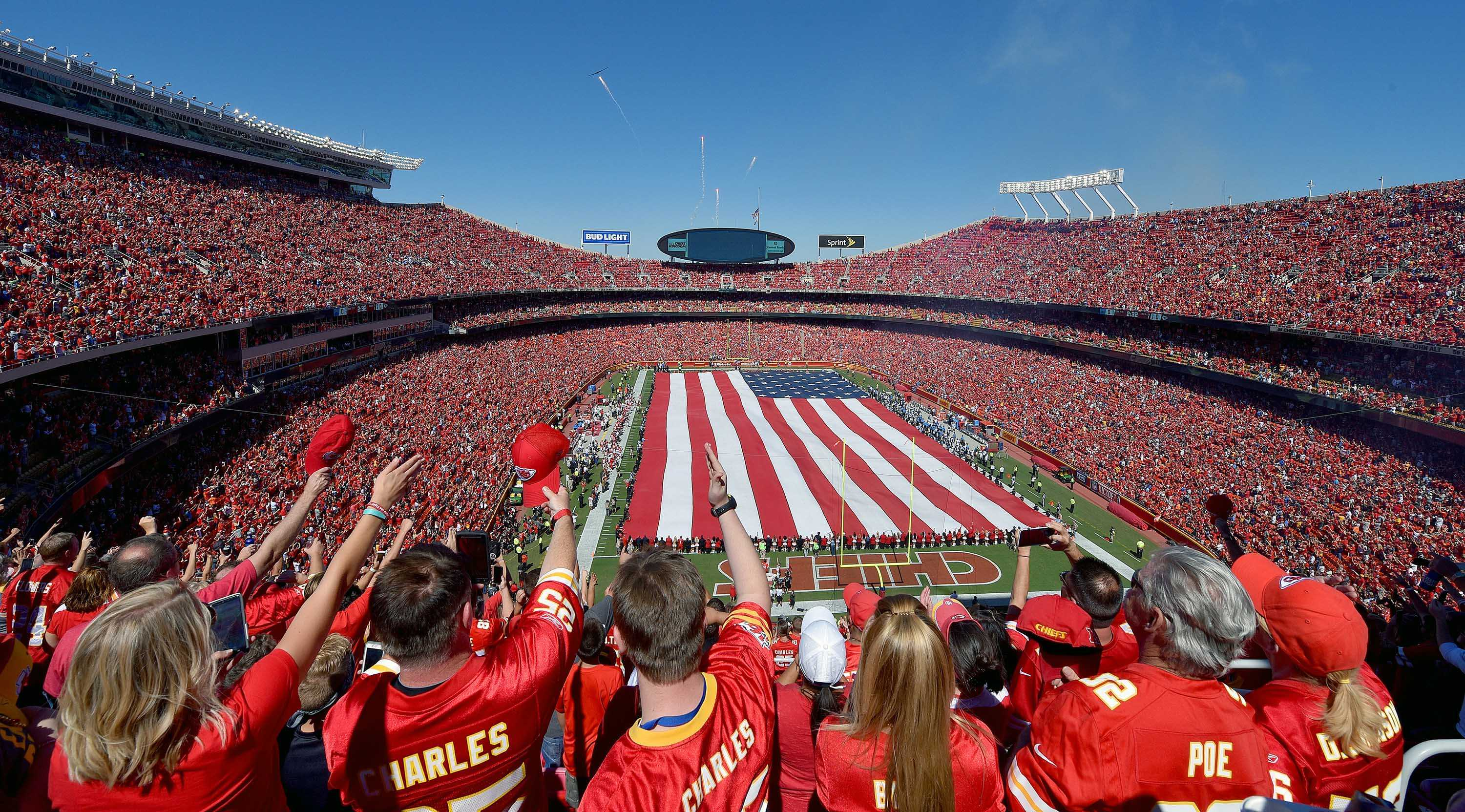 Kansas City Chiefs fans salute at the end of the National Anthem as a B2 stealth bomber and fireworks fly overhead before a football game against the San Diego Chargers on Sunday, September 11, 2016 at Arrowhead Stadium in Kansas City, Missouri (John Sleezer/Kansas City Star/TNS)