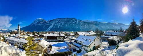 Sunny winter's day panorama of Kiefersfelden in the river Inn valley with Kaiser mountains, Bavaria Germany