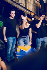 Girl throwing a ball. Beer Pong Vienna 2019
