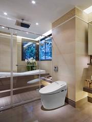 Contemporary beige luxury bathroom design, modern bathroom decorating idea, glass shower stall, smart bidet toilet