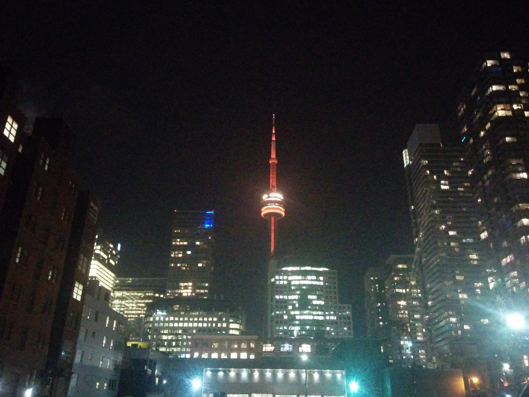 Looking south from Richmond Street at the CN Tower in red #toronto #cntower #richmondstreet #entertainmentdistrict #skyline #lights #night #red