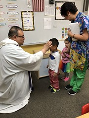 Fr. Juan gives ashes to preschool.