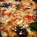 Pinoli Pizza Goat's cheese, mozzarella, caramelised balsamic onions, sunblush tomatoes, pine nuts, riserva cheese & basil.