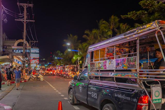 A songthaew driving along beach road in Pattaya, Thailand