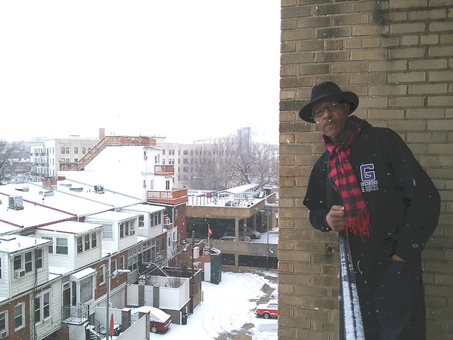A photo of Moyo standing on his balcony.