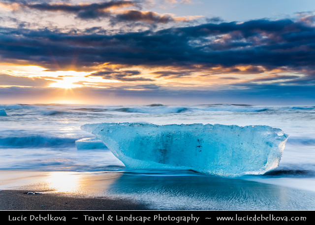 Iceland - Jökulsárlón Glacier Lagoon - Black Sand beach with Piece of Ice at Sunrise