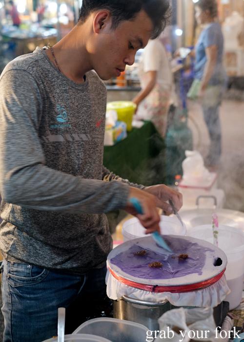 Making khao kriap pak mor steamed rice flour dumplings at Build Market in Khao Lak,Thailand