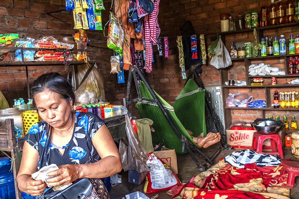 Vietnamese shop owner in a Rade village--Ea Kly