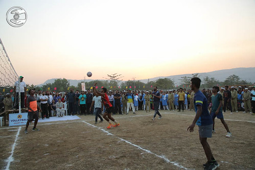 Devotees playing Volleyball