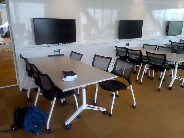 Wall mounted LCD screens and desks on wheels at ANU Marie Reay Teaching Centre