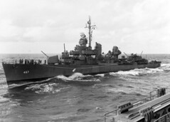 USS Strong (DD 467) highlines mail to USS Honolulu (CL 48) during operations in the Solomon Islands area, circa early July 1943. (U.S. Navy)