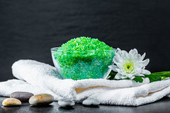 Bath salts and a clean white towel - the concept of a relaxing Spa
