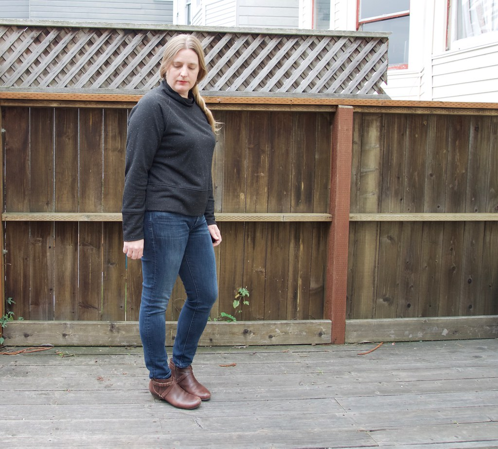 Foxthreads wearing the Toaster sweater #1 in black french terry with jeans and booties.