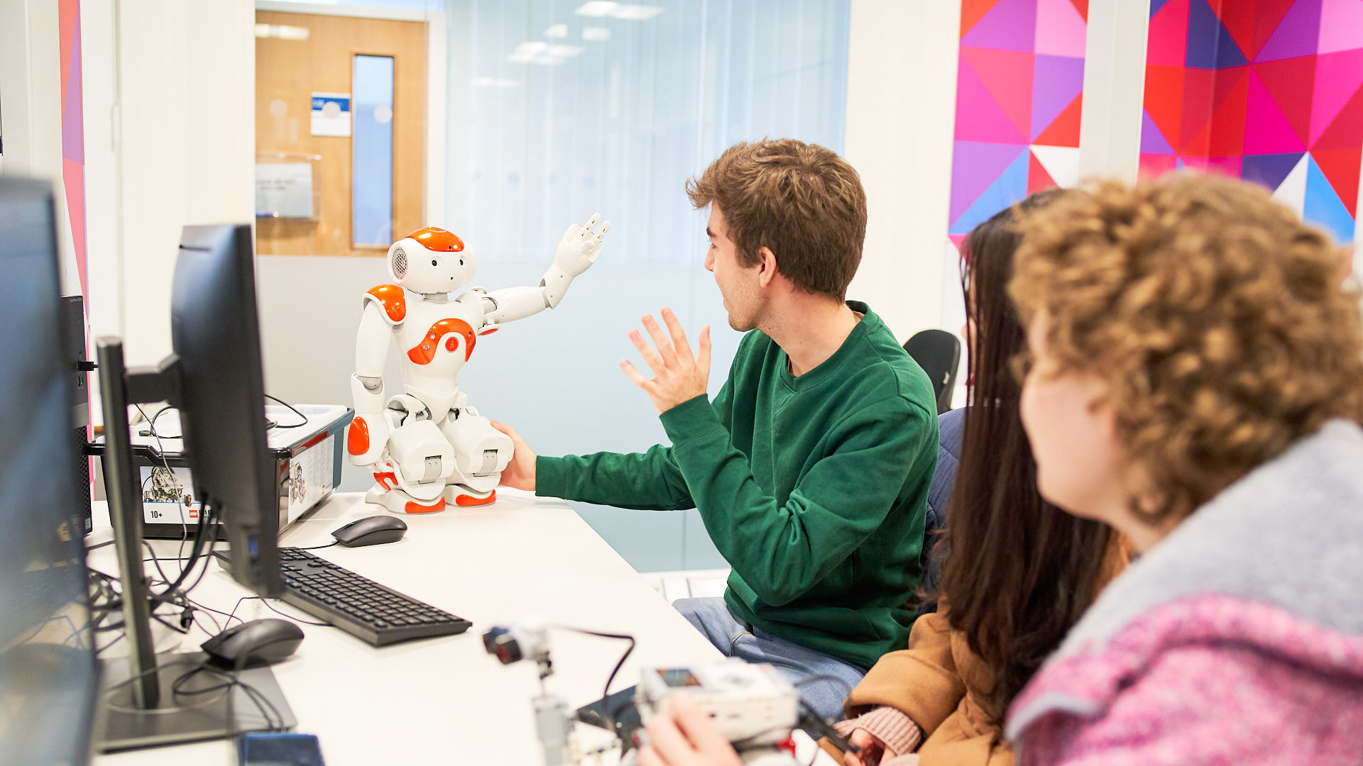 PhD students working with robots