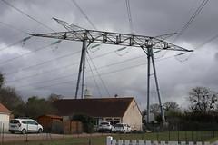 power grid above homes in nuclear village of Saint Lauren Nouan