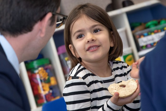 A toddler at Tysons Corner Children's Center eating a bagel