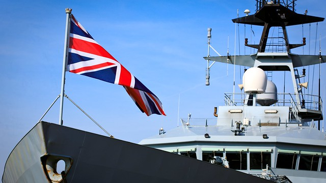 British warship displaying its Union Jack flag
