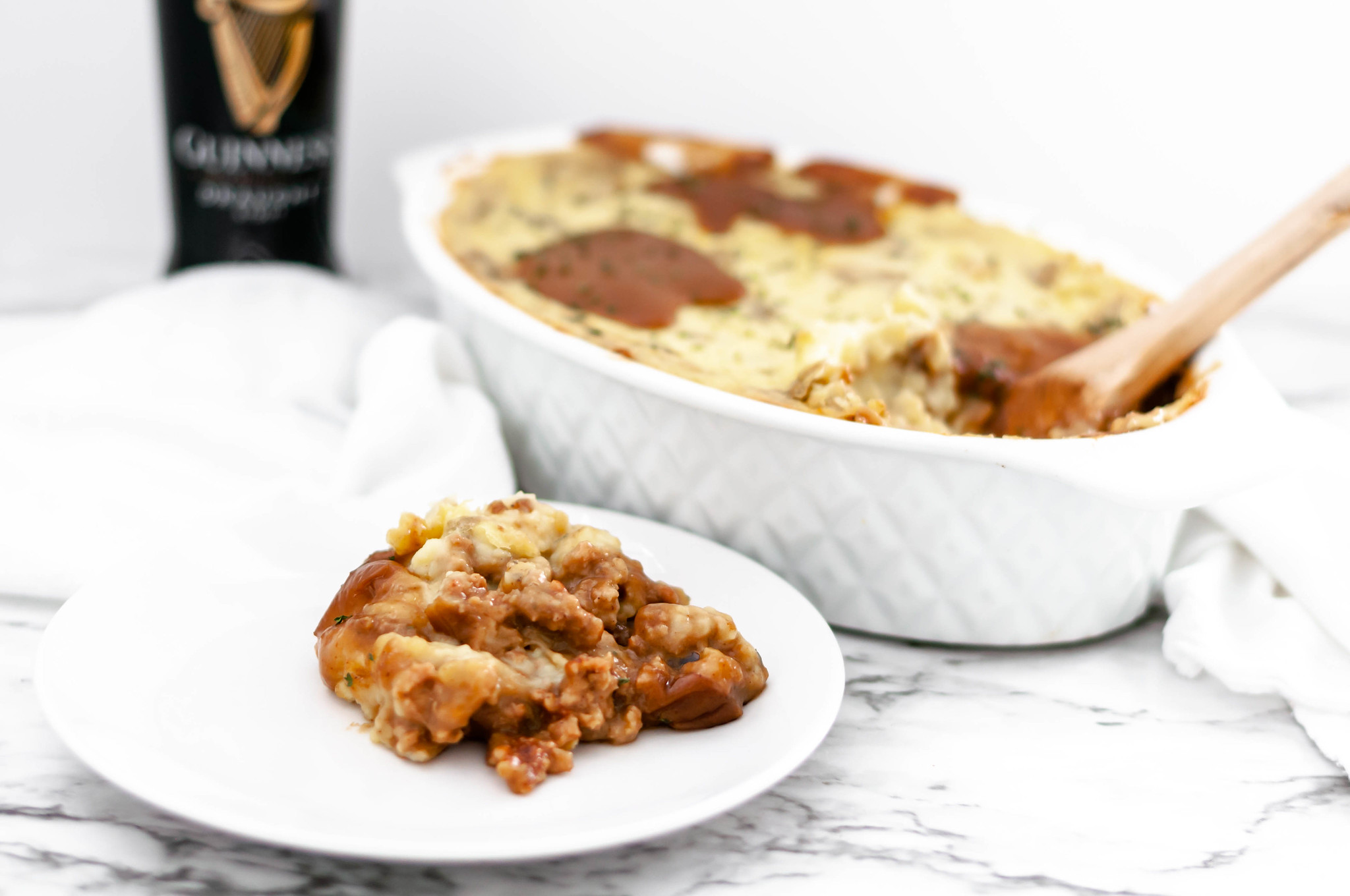 This rich and hearty Bangers and Mash Casserole would be perfect for St. Patrick's Day. All the classic flavors and ingredients of Bangers and Mash combined into a hearty casserole.