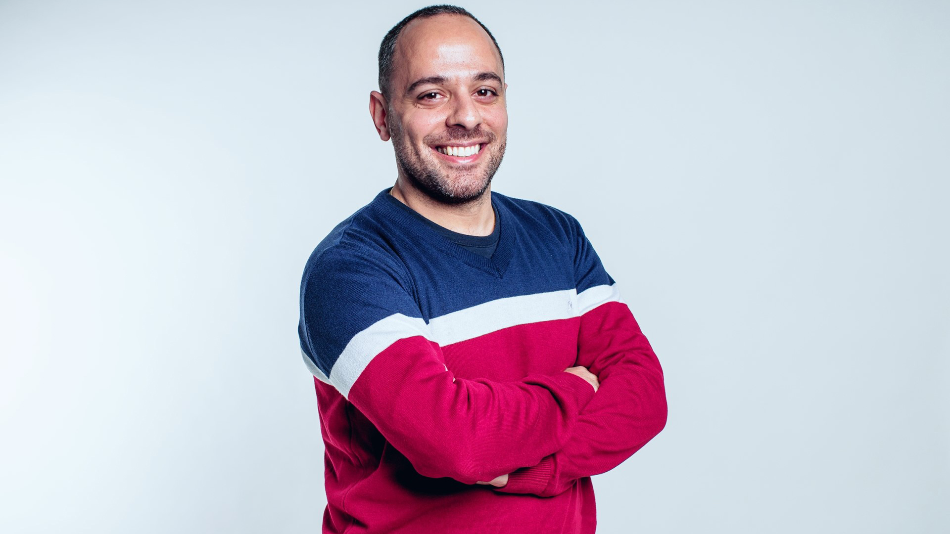 A studio portrait of DBA student Amine Moussa