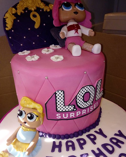LOL Doll cake with handmade figures, a huge 9 inch double barrel cake that weighed a ton. By Bex Essex