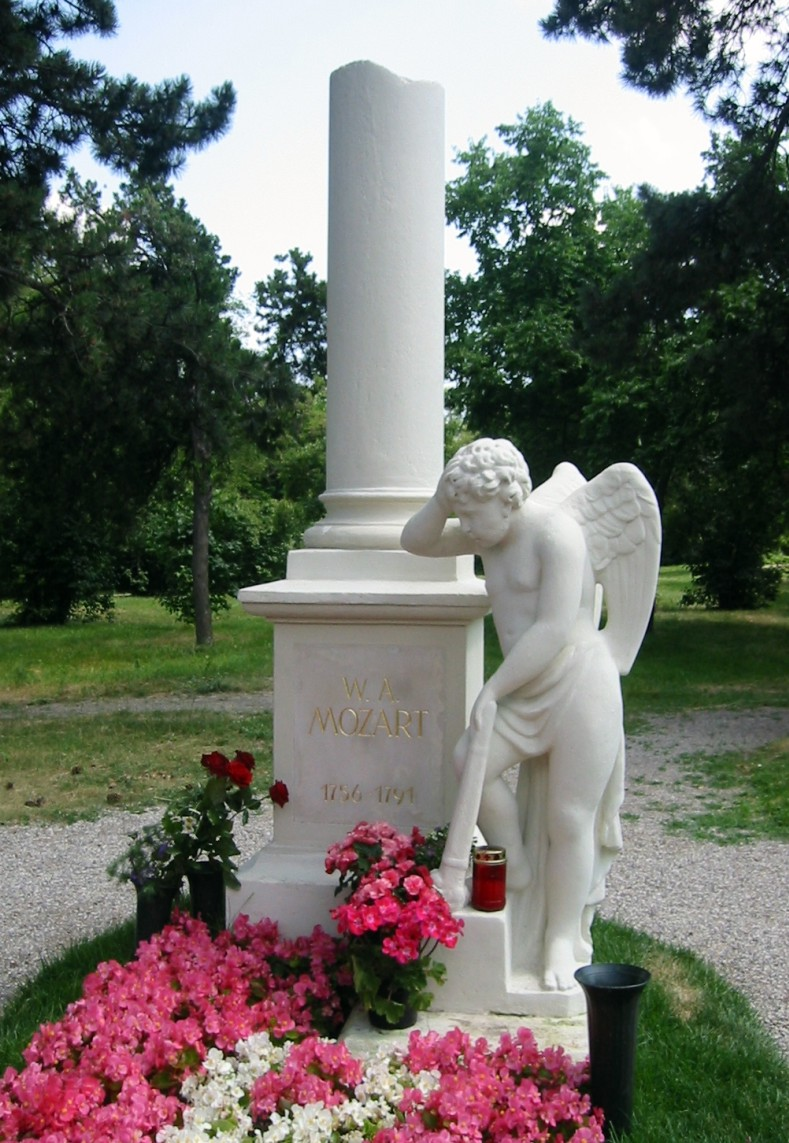 The gravestone of Wolfgang Amadeus Mozart at St. Marx Cemetery (Sankt Marxer Friedhof) in the Landstraße district of Vienna. Later attempts to locate his mass grave all failed, including a search by his widow, 17 years after Mozart's death, and by Vincent Novello in 1829. In 1855 a gravestone was erected at what was presumed to be the correct spot. Later the stone was transferred to a group of famous musician graves at Zentralfriedhof. At St. Marx Cemetery, a worker replaced the gravestone with a memorial tablet, which was again expanded by several contributors. The memorial known today was refurbished by Viennese sculptor Florian Josephu-Drouot in 1950. Photo taken on June 25, 2006.