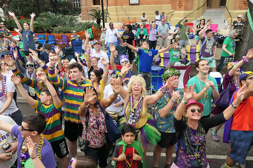 This cheerful crowd begs for beads
