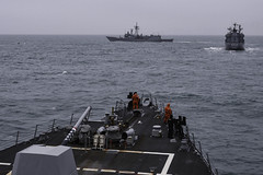 USS Gravely (DDG 107) conduct surface exercises with German and Polish navy ships.