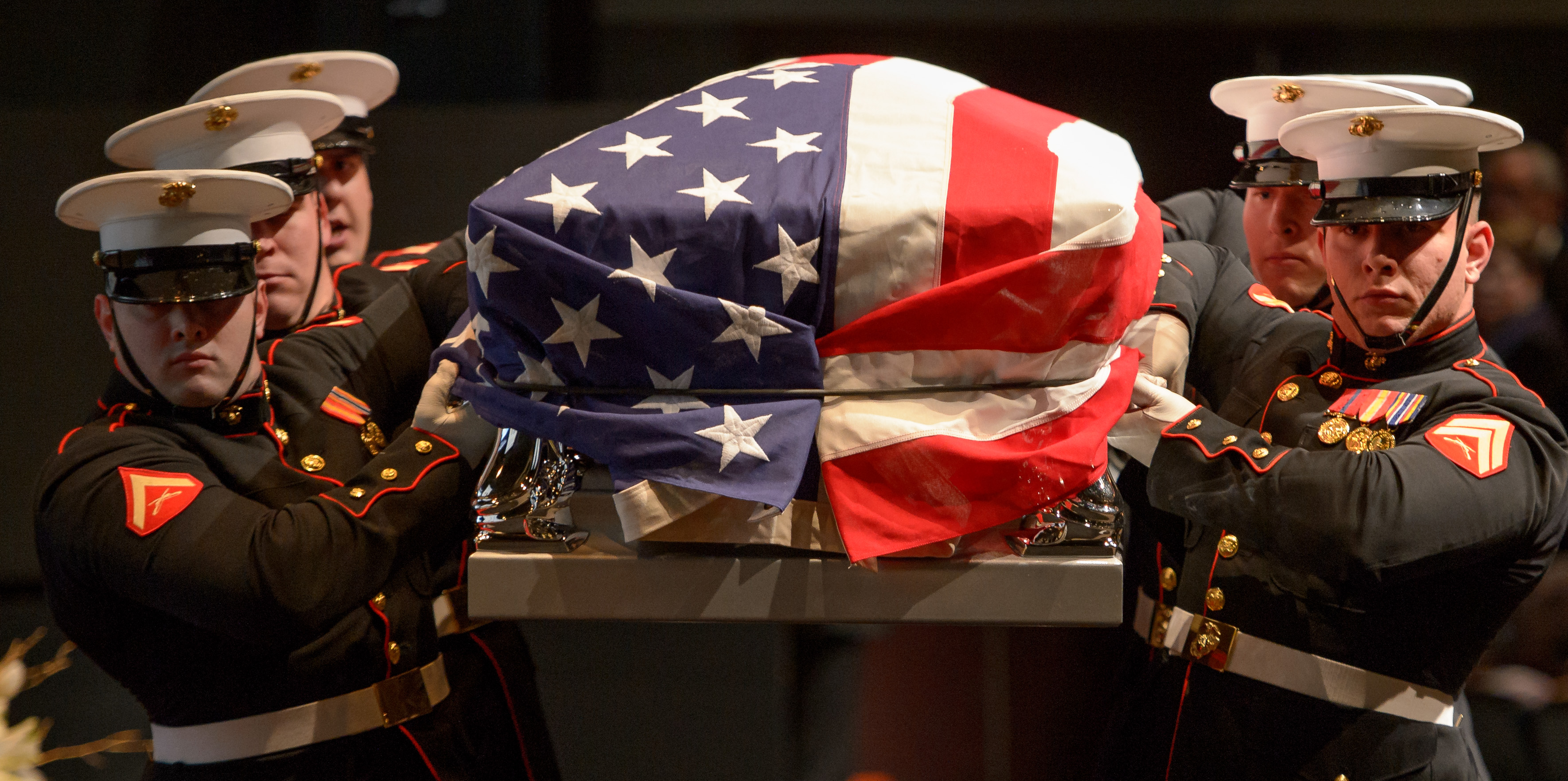 Marine Corp pallbearers bring carry former astronaut and U.S. Senator John Glenn into a service to celebrate his life, Saturday, December 17, 2016 at The Ohio State University, Mershon Auditorium in Columbus. Photo Credit: (NASA/Bill Ingalls)