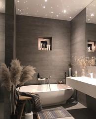 Luxury contemporary bathroom design, modern bathroom decorating idea, freestanding bathtub, marble tiled
