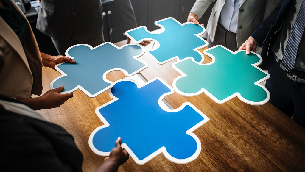 jigsaw pieces joining together