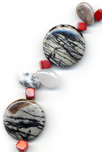 Detail of red coral, large round Spiderweb Jasper and teardrop agates