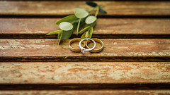 Wedding rings on a wooden table