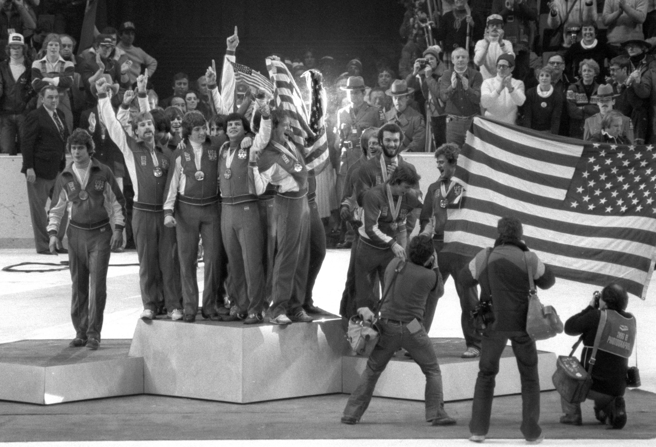 The United States Olympic Hockey Team atop the gold medal podium at the medals ceremony following their victory over Finland in Lake Placid, New York, on February 24, 1980.