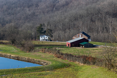 house dwelling residence farm mill georgetown ohio unitedstates us tunnelmill buildings structures reservoir water pond trees forest slope hillside valley grass landscape pleasanttownship browncounty