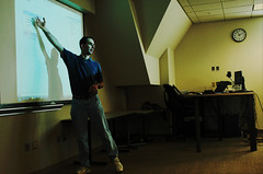 Instructor teaching coding, white board, projection, desk, computers, laptop, iSchool, University of Washington, Seattle, USA