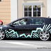 K-Custom Black VW Golf Mk6 with green graphics
