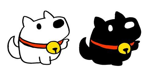 首輪が赤い白と黒のご神犬