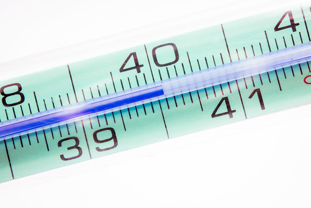 High fever with thermometer showing a body temperature above 40°C