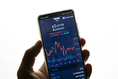 A smartphone displays the Tron market value on the stock exchange
