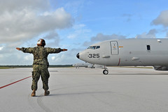 Airman Makoa Turner, assigned to Patrol Squadron (VP) 47, launches a P-8A Poseidon to the flightline at Andersen Air Force Base, Guam, during exercise Sea Dragon, Jan. 17. (U.S. Navy/MC1 Kevin Flinn)