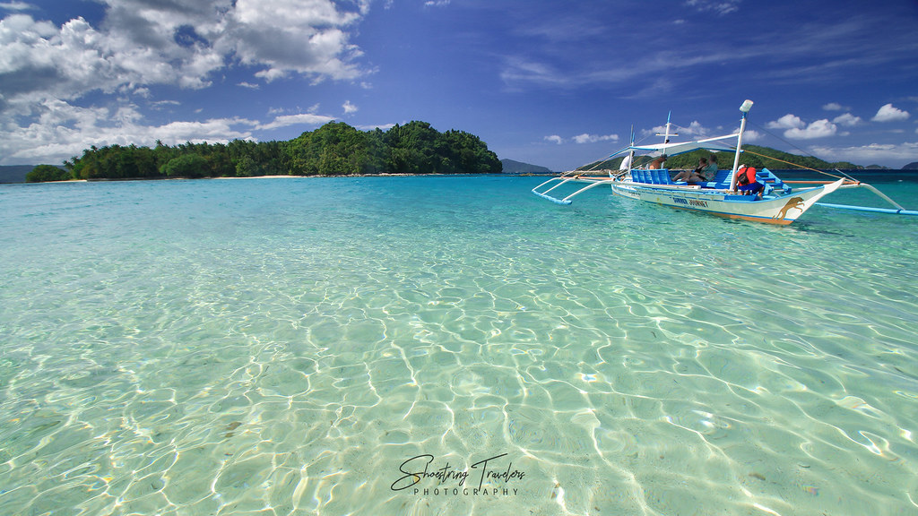 crystal-clear waters at Paradise Island with Inadauan Island in the background