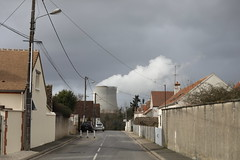 Nuclear cooling towers and houses in village of Saint Laurent Nouan